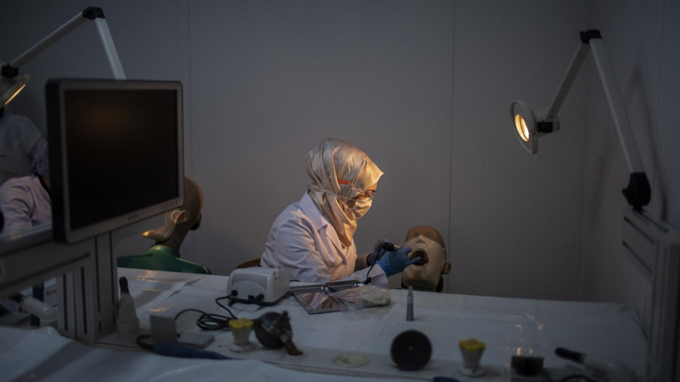 Sidra attends a practical lesson at Istanbul University, where she is studying dentistry.