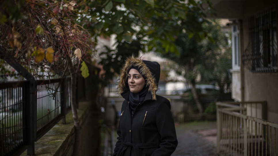 Sidra stands outside her home in Canda Sok on the outskirts of Istanbul.