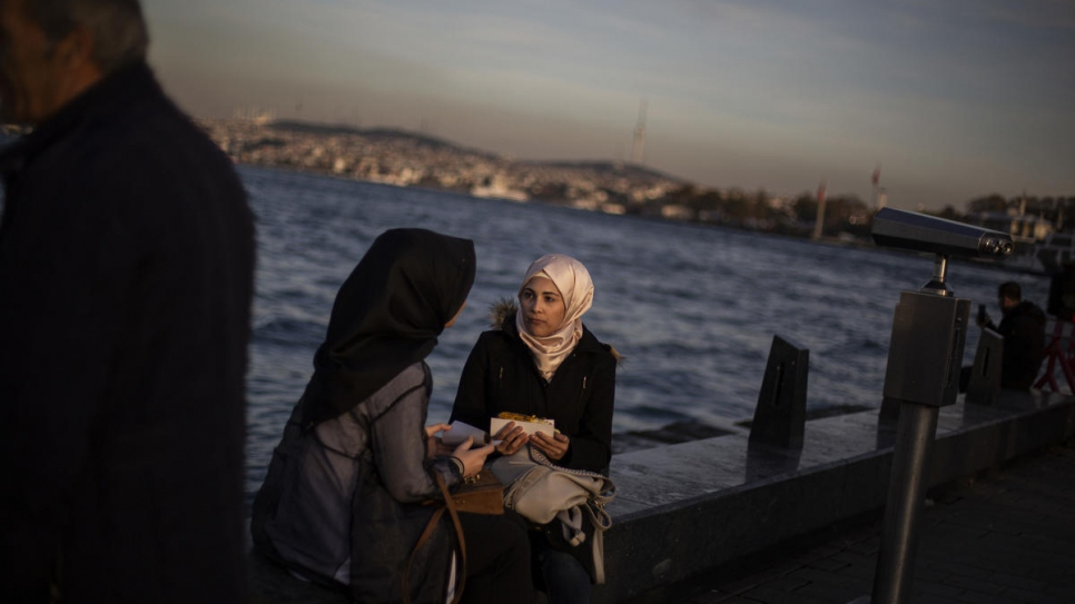 Sidra spends time with a friend on the historical Galata Bridge in Istanbul.