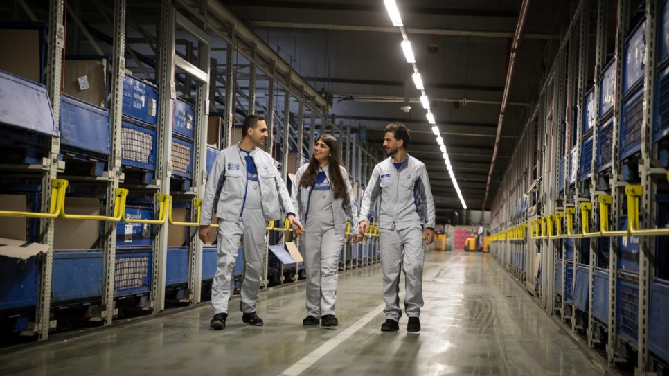 Mastura Ekhlas (centre), Mohamad Al Jaser (left) and Mustafa Hussain (right) at the VW plant in Baunatal. Germany.