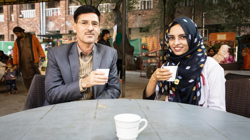 Saleema takes a short tea break outside the hospital with her father, Abdul Rehman.