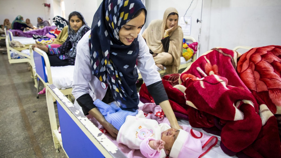 Saleema treats babies and their mothers at the hospital.