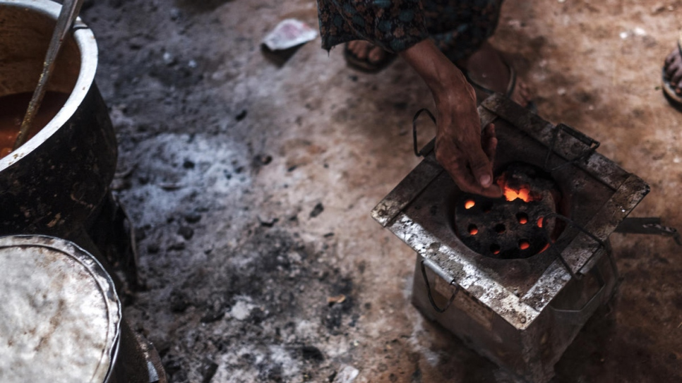 Burning briquette. This alternative energy provides income for Somali refugees and for local communities in Ethiopia.