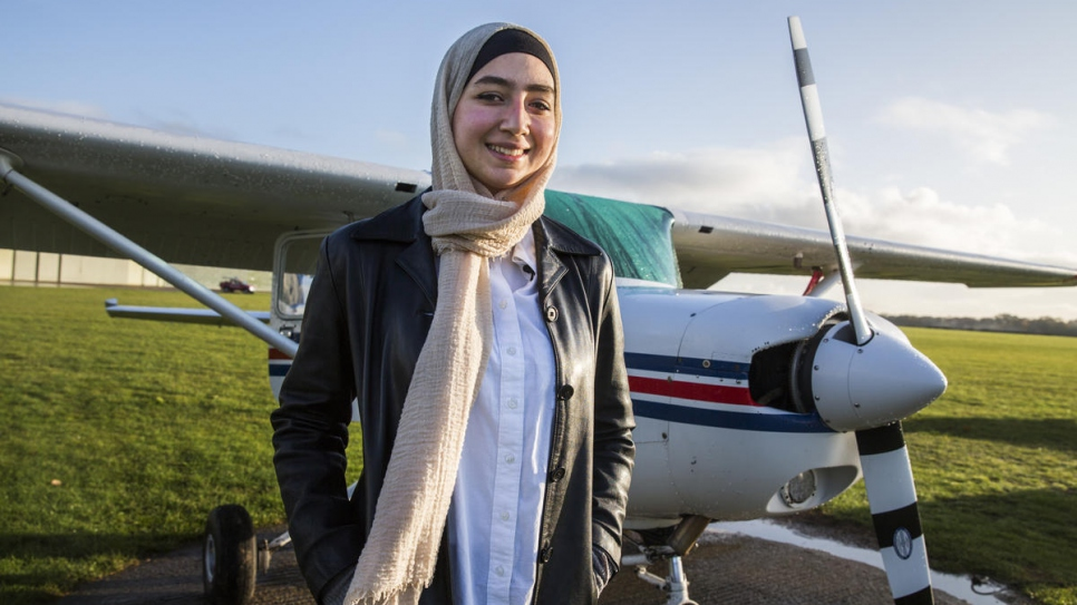 Maya Ghazal, 20, pictured in front of the plane in which she will make her first solo flight, at The Pilot Centre, in Denham, United Kingdom.