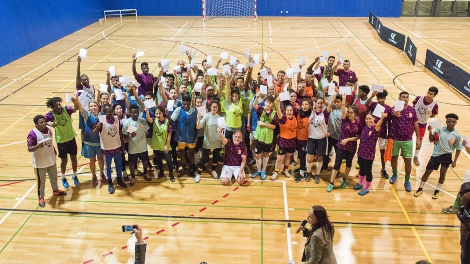 White card moment. Refugees join local players, diplomats and UN staff in teams competing in an indoor football tournament as part of the Global Refugee Forum