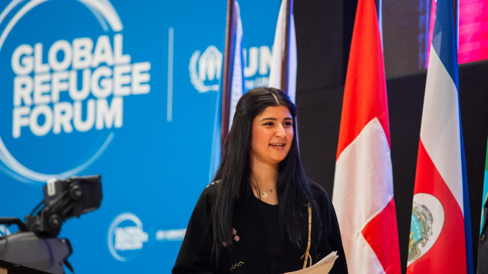 Aya Mohammed Abdullah, a former Iraqi refugee now living in Switzerland, addresses delegates at the Global Refugee Forum..