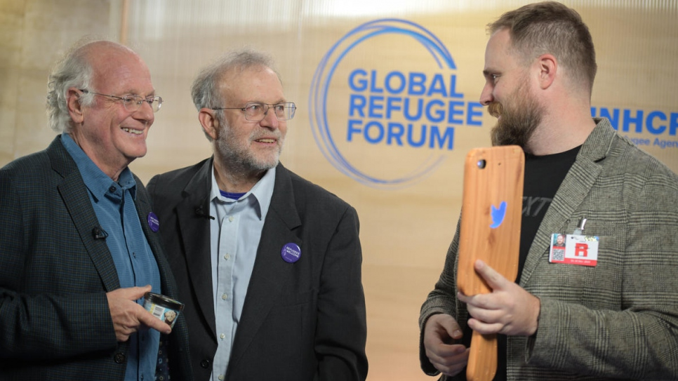 Ben Cohen (left) and and Jerry Greenfield, founders of Ben & Jerry's ice cream, visit the Global Refugee Forum.