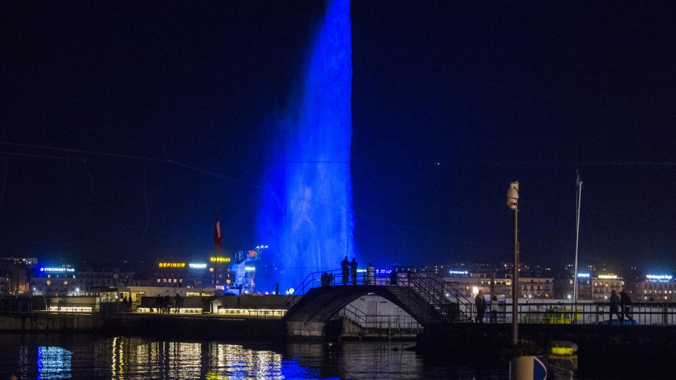 View of the famous Jet d'eau, symbol of the city, illuminated in blue for the GRF
