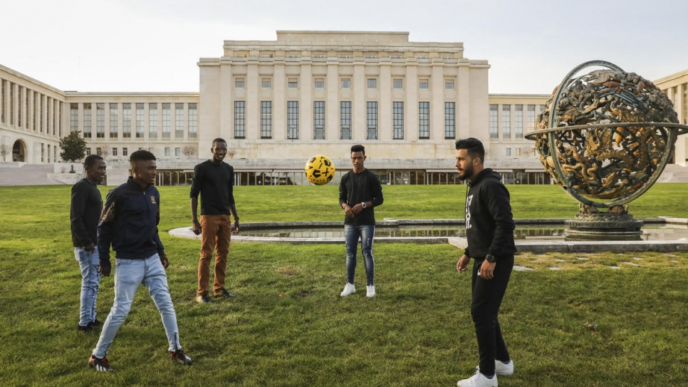 Refugees and asylum seekers attending events around the Global Refugee Forum play football at the Palais des Nations.