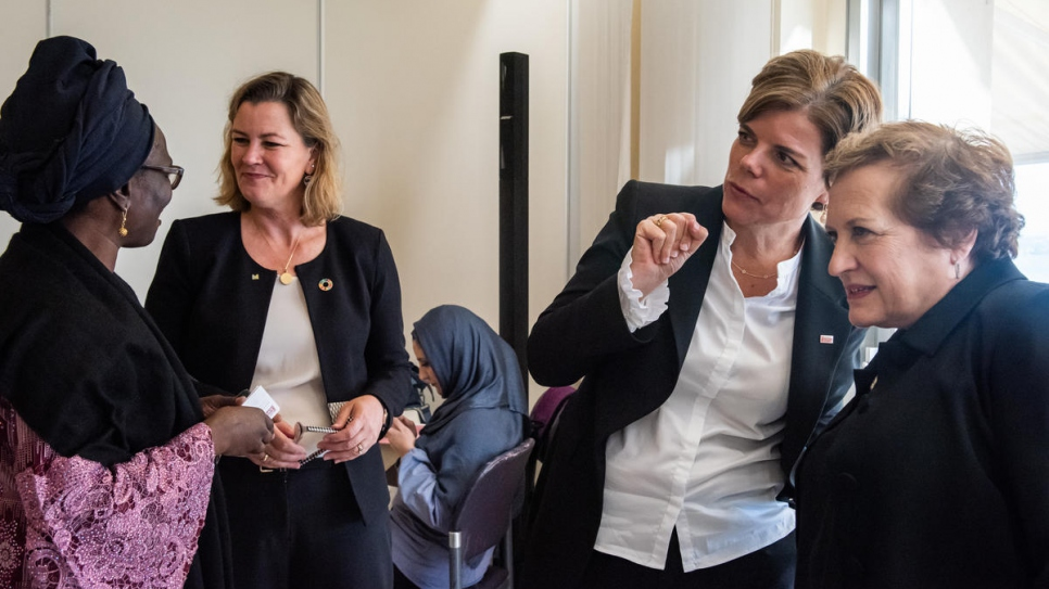 Deputy High Commissioner Kelly Clements hosts a round-table lunch for women, including refugees, to discuss ways of removing barriers to refugee women's inclusion in decision making.