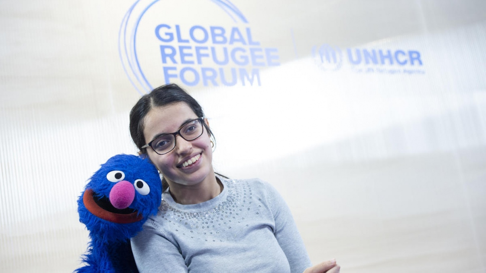 "Nujeen Mustafa, Refugee from Syria is interviewed by Grover, the fluffy blue muppet from the US children's educational television series ""Sesame Street""."