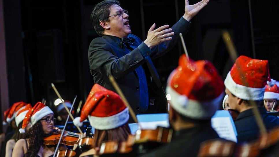 Venezuelan-born conductor Víctor Mata directs Panama Philharmonic Orchestra during a Christmas Concert dedicated to refugees and asylum seekers.