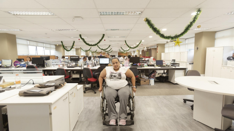 Gabriela Peña in the office where she works in São Paulo, Brazil. She found the job after being relocated from the border state of Roraima.