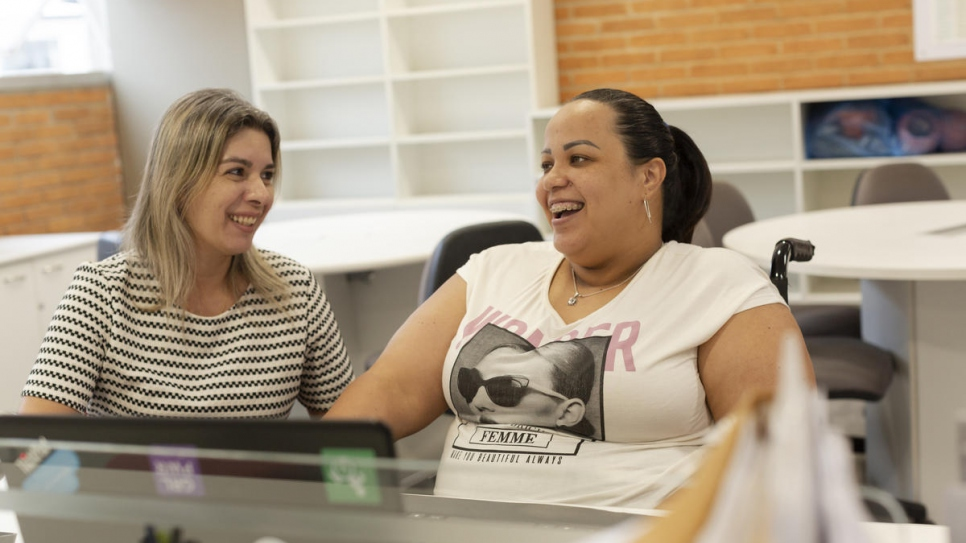 Gabriela Peña chats with her boss, Eliane Brito, in the Human Resources department of a laboratory in São Paulo, Brazil.