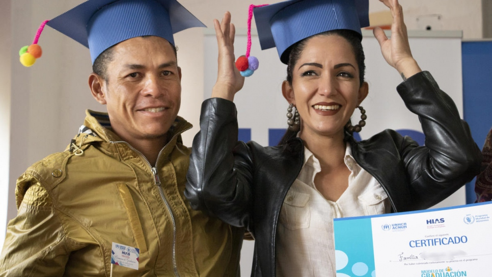 Venezuelans Osmar and Valeria at the ceremony marking the end of their participation in a training program aimed at giving them the skills to provide for themselves in their new home, Ecuador.