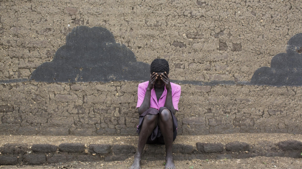 South Sudanese refugee Rose*, 33, sits outside her shelter in Uganda's Bidibidi settlement. She has been receiving counselling since July 2019, after she tried to take her own life.
