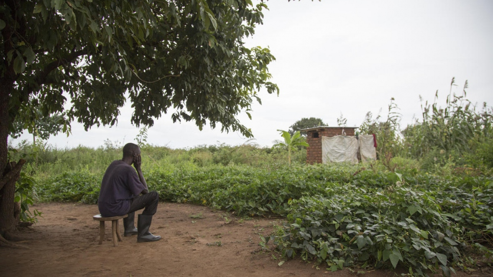 South Sudanese refugee and father of five Adam* sits outside his shelter in Uganda's Bidibidi settlement. His wife Mary* was diagnosed with bipolar disorder in 2012 and later took her own life in exile.