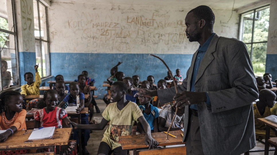 South Sudanese refugee James Tut teaches a primary school class in Jewi camp, Ethiopia.