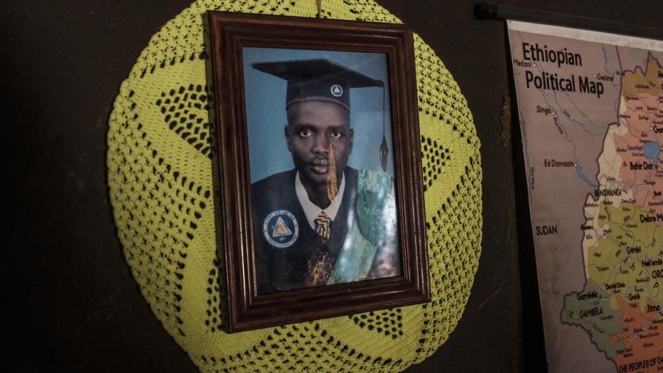 """I have been able to transfer the benefits of university to my family. I want the same for my children."" A picture of South Sudanese refugee teacher, James Tut, hangs on the wall of his home in Jewi camp, Ethiopia."