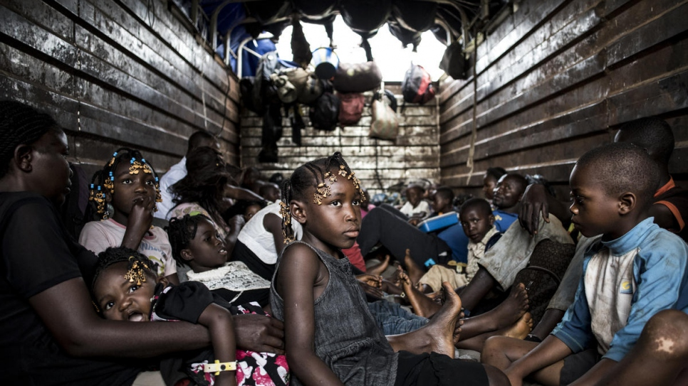 Young Congolese returnees travel in a truck as they are repatriated from Angola to Kananga in the Kasai province of the Democratic Republic of the Congo (DRC).