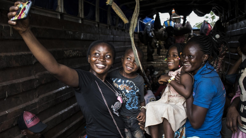 Congolese returnees take selfies as they are repatriated from Angola back to Kananga in the Kasai province of the Democratic Republic of the Congo (DRC).