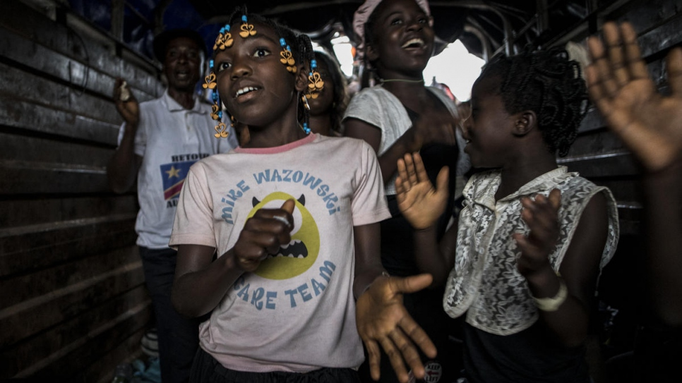 Young Congolese returnees sing as they are repatriated from Angola to Kananga in the Kasai province of the Democratic Republic of the Congo (DRC).
