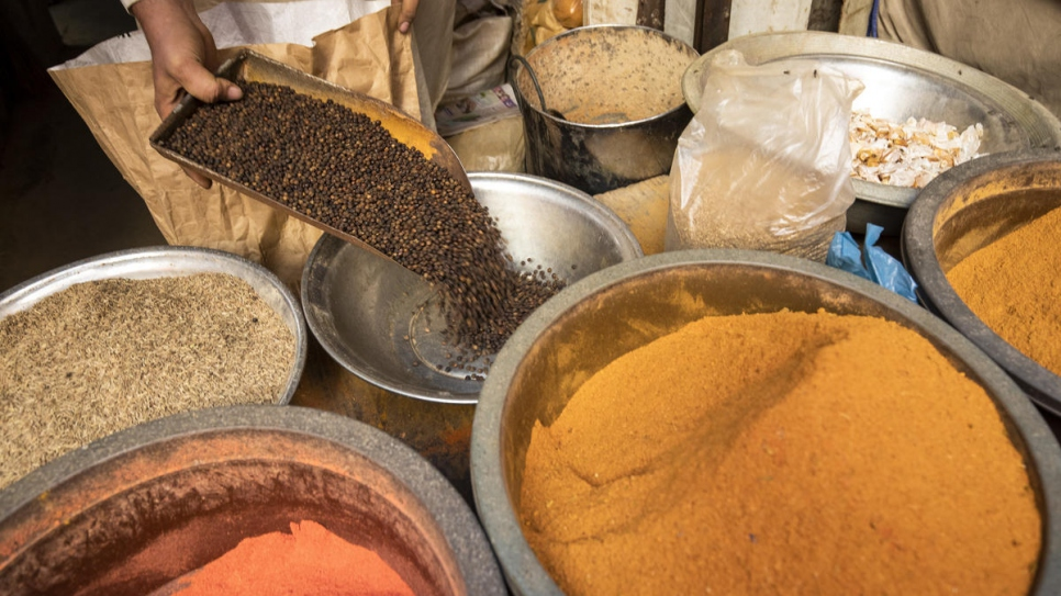 Mohammad refills his spices at his shop in Al-Asif Square market, Karachi.