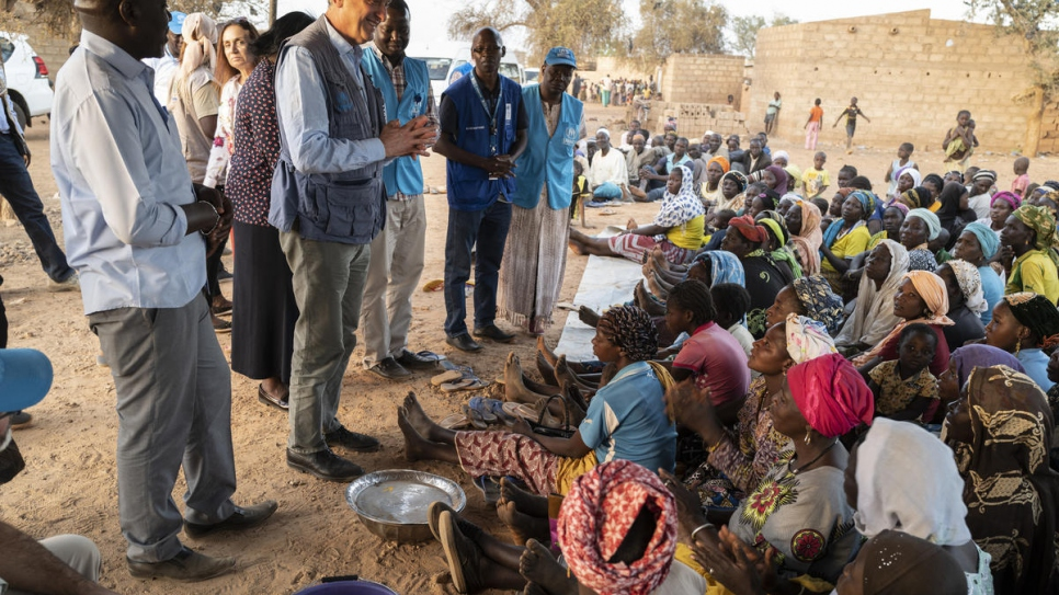 UN High Commissioner for Refugees Filippo Grandi meets with displaced Burkinabés in the town of Kaya in Burkina Faso's Center-North region