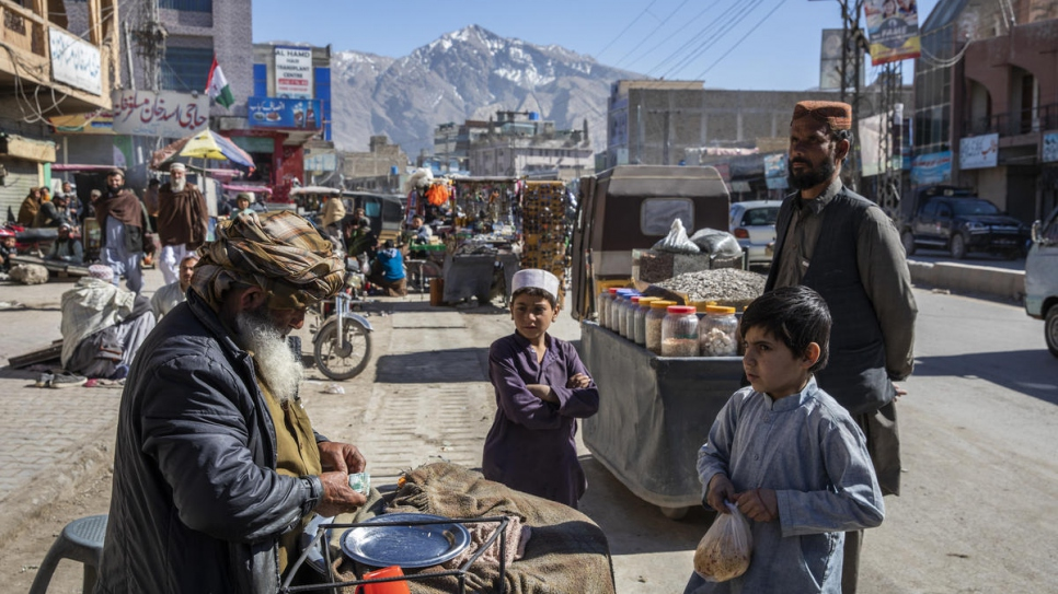 Nadia's father, Abdul Rashid, sells qabli – an Afghan dish made with rice, chicken, raisins and cumin – on a street in Quetta.