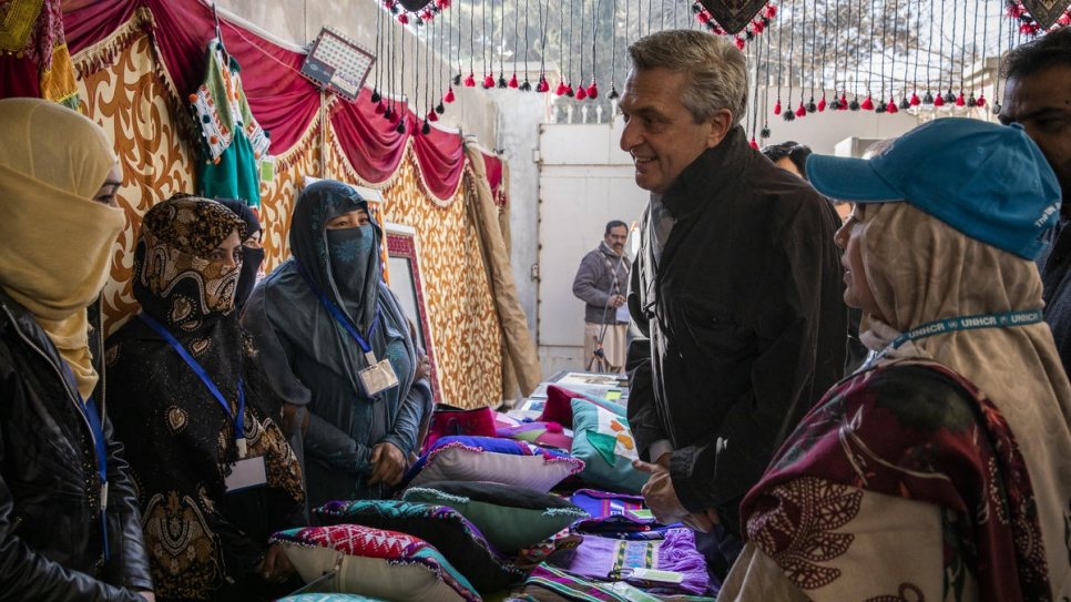UN High Commissioner for Refugees Filippo Grandi meets with Afghan refugee women working to develop their handicraft skills through the Safe for the Start programme in Quetta, Pakistan.