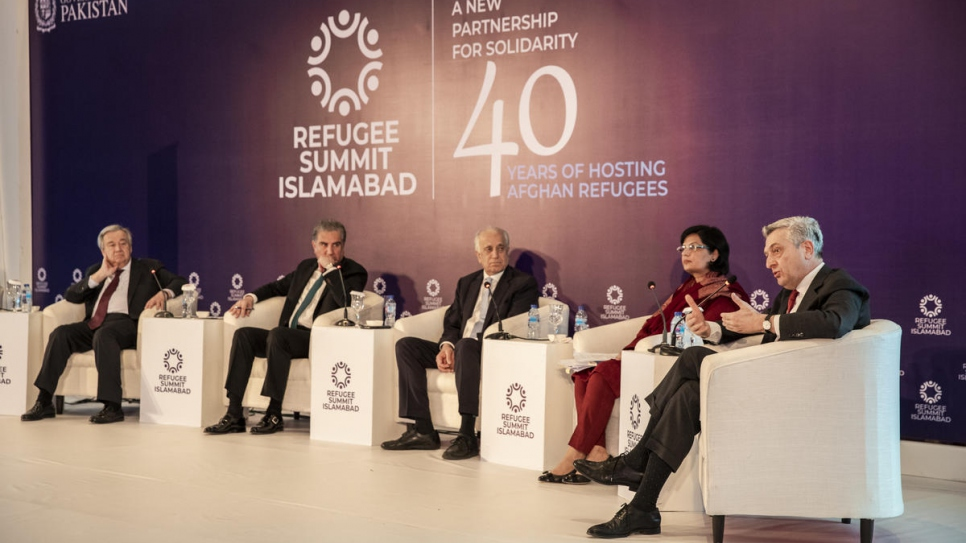 UN High Commissioner for Refugees Filippo Grandi (right) speaks during a panel discussion at the Refugee Summit in Islamabad.