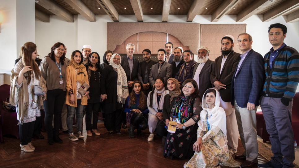 UN High Commissioner for Refugees Filippo Grandi meets with a group of refugees, many of them Afghans, at a hotel in Islamabad on the eve of the Refugee Summit.