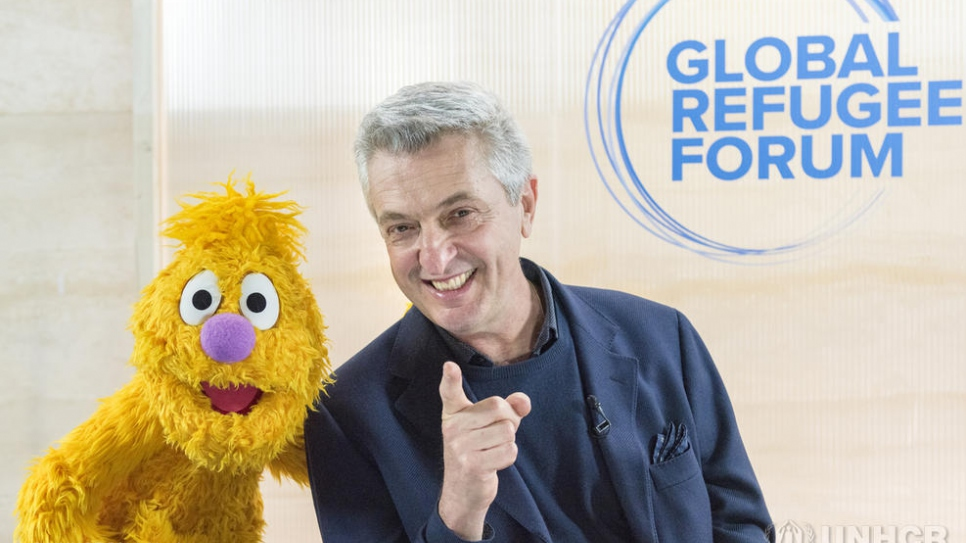 UN High Commissioner for Refugees Filippo Grandi meets Jad from Sesame Street, who is visiting the Global Refugee Forum in Geneva.