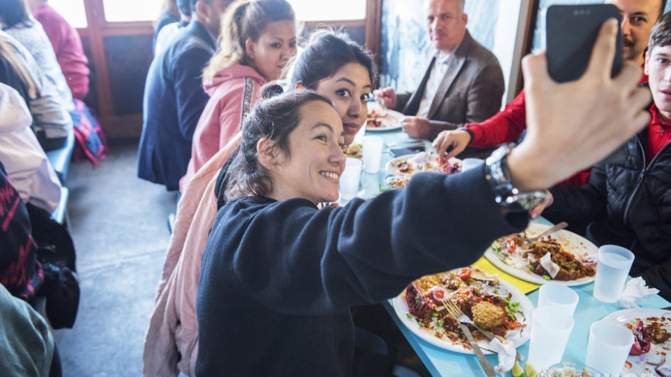 The popular restaurant at the lakefront Bains des Pâquis provides lunch for a group of refugees – attended by UN High Commissioner for Refugees Filippo Grandi – during the Global Refugee Forum in Geneva.