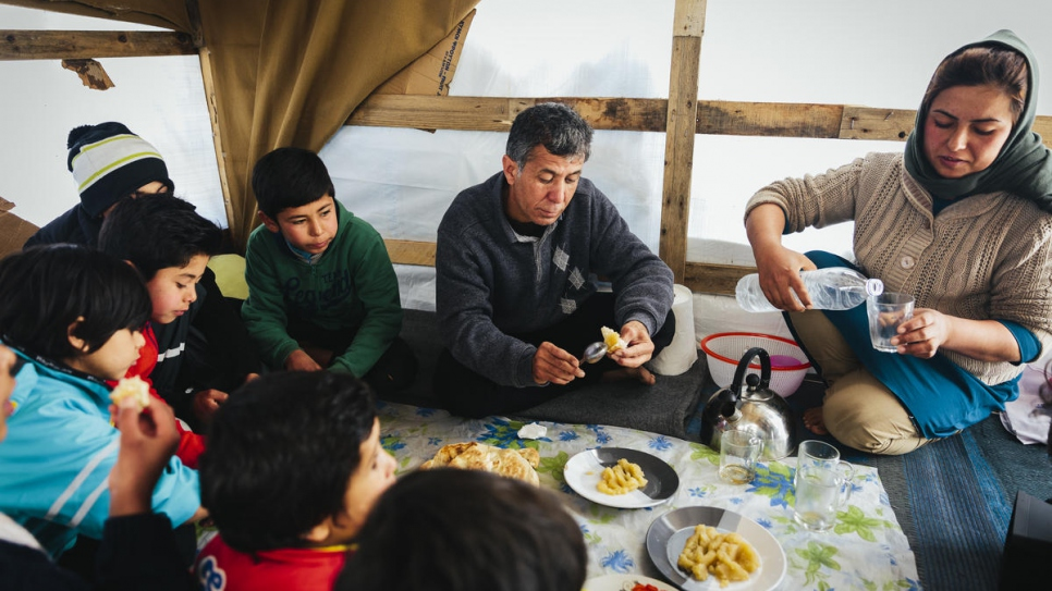 Sardar has breakfast with his wife, children and nephews inside the small hut the family shares at a makeshift camp adjacent to the Moria reception and identification centre on Lesvos.