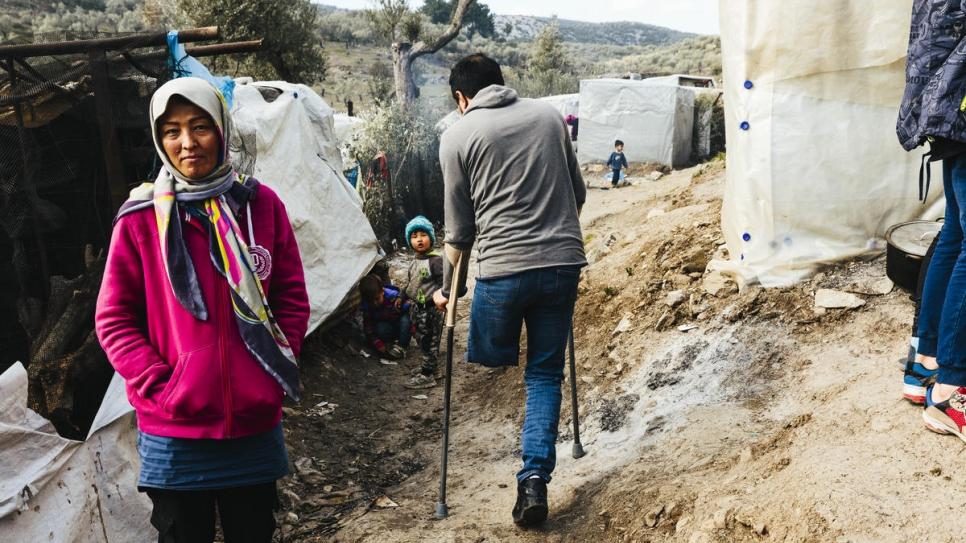 An Afghan asylum-seeker who lost a leg walks through a makeshift camp adjacent to the Moria reception and identification centre on the Greek island of Lesvos.