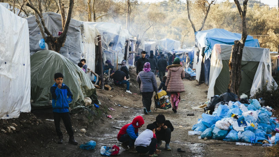 Afghan asylum-seekers seen at a makeshift camp adjacent to the Moria reception and identification centre on the Greek island of Lesbos.