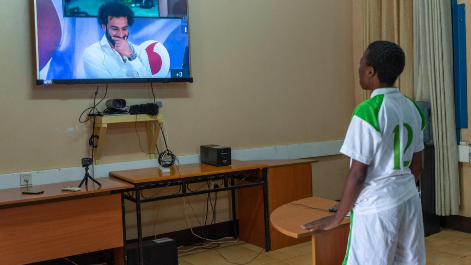 Bitisho Bugoma, a football player with Kakuma Stars, an all-girls refugee football team from Democratic Republic of the Congo, asks a question of football star Mohamed Salah. Young refugees watched Salah on Tuesday from Kakuma refugee camp in Kenya.