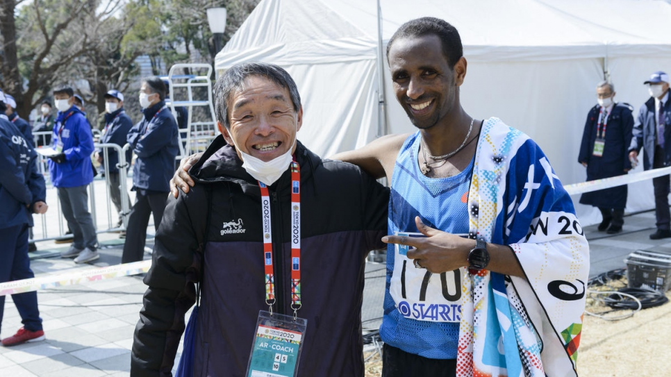 After the race Yonas celebrates with his coach in Japan, Naruyosi Karasawa.