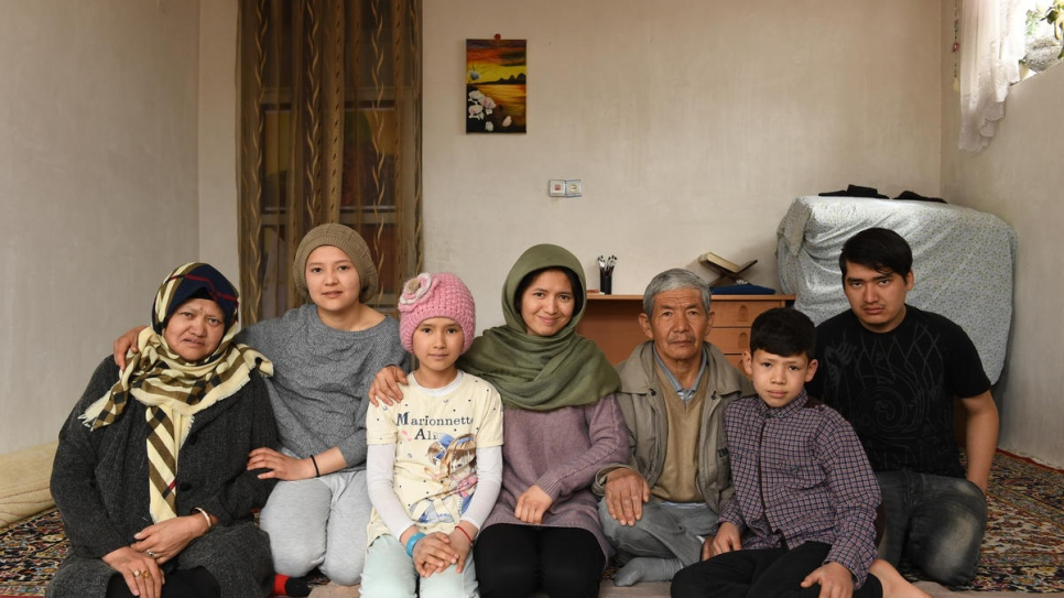 Twenty-seven-year-old Afghan returnee Kobra Yusufy (centre) sits for a portrait with her parents and siblings (from left) Saira Yusufy, 45, Maryam, 18, Hora, 10, Mohammad, 56, Mahdi, 11, and Mohammad Ali, 24.