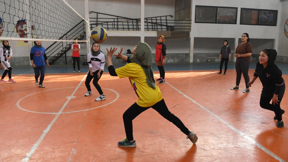 Twenty-seven-year-old Afghan returnee Kobra Yusufy attends volleyball training at a gym in Kabul, Afghanistan.