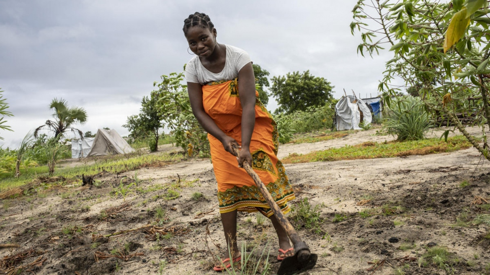 Angelina, 31, works on the piece of land the government attributed to her and her husband in Mutua settlement.
