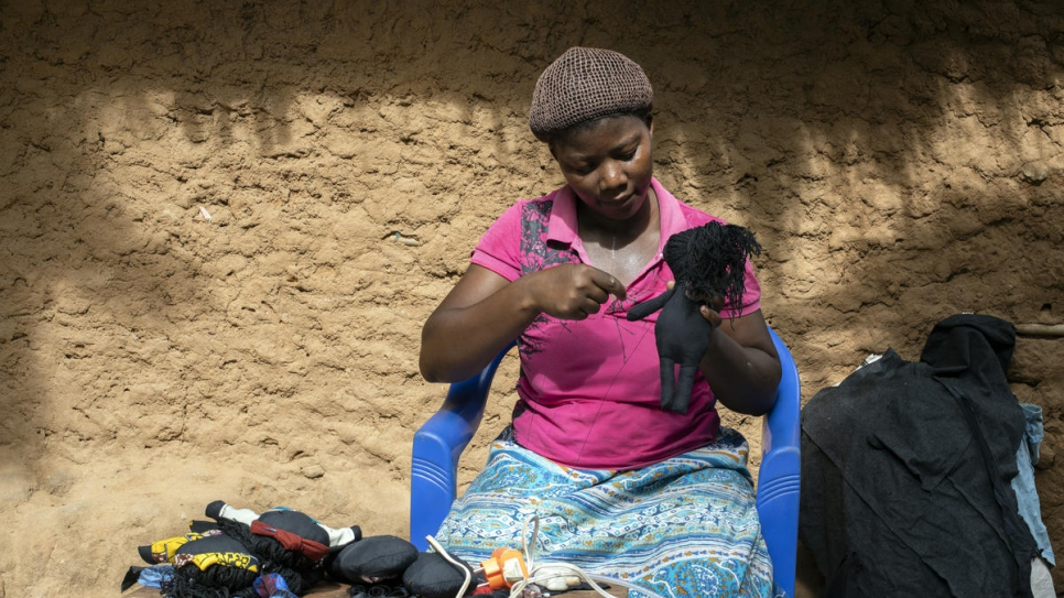 Congolese refugee Kituza, 25, finds healing with each doll she makes in Maratane refugee camp, Mozambique.