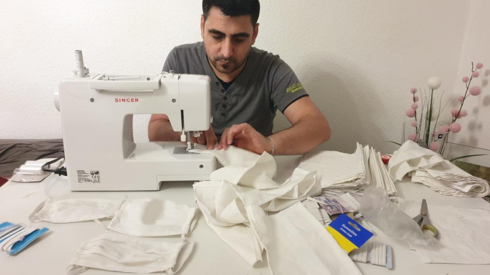 Rashid Ibrahim, a tailor from Syria, now living in Seddiner See near Potsdam, Germany, is sewing face masks to support his local community in the fight against the Corona virus