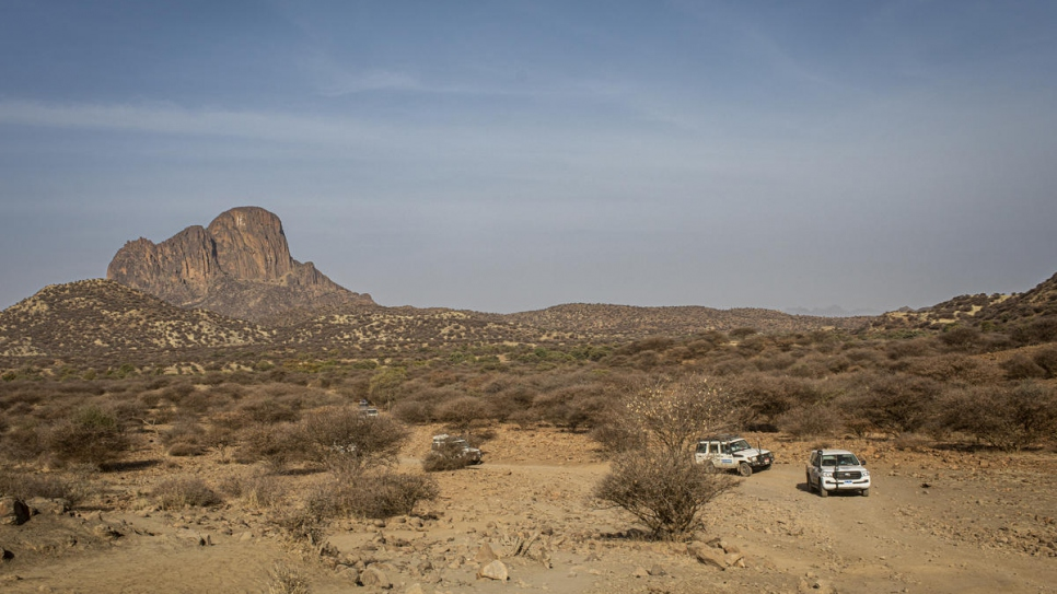 A convoy of UNHCR vehicles travels through the Jebel Mara mountain range on its way to Kabkabiya, North Darfur. The mountainous region saw extreme violence and displacement in the mid-2000s.