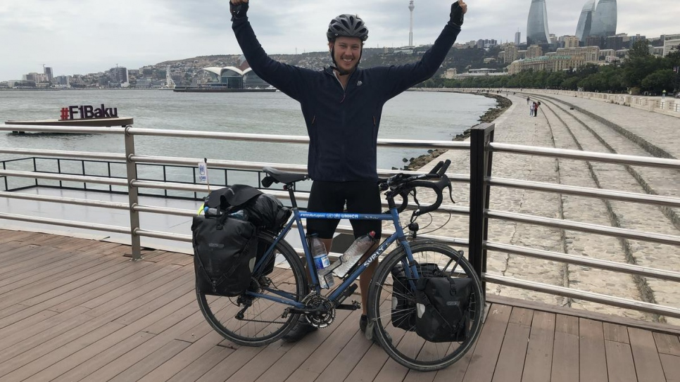 Theo Foster arrives at the Caspian Sea after cycling 3,500 miles overland from Geneva, Switzerland, to Baku, Azerbaijan.