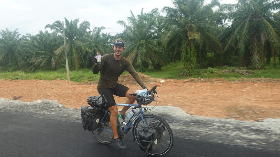 British cyclist Theo Foster rides through the Malaysian peninsula during his round-the-world trip.