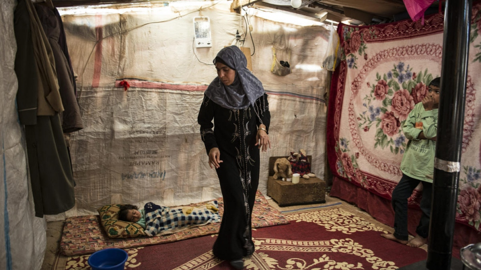 Archive photo of Syrian refugee Hasna in her tent in the Bekaa Valley, Lebanon, in March 2014.