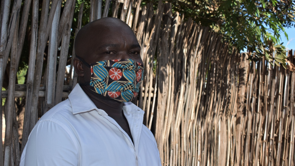 Refugee tailor Maombi Samil makes facemasks at his shop in Kenya's Kakuma camp. His is one of the many refugee-run businesses helping to fight COVID-19.