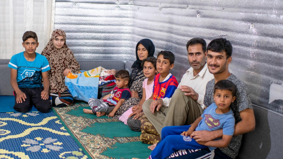 Syrian refugee Ahmad Hussain (third from right) and his family in their shelter at Jordan's Azraq refugee camp.